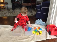 Toddler Activity! Washing toys. This activity really helped my 16 month old take his mind off of being sick. He immediately went from fussing and crying to pleasantly content. Nice little break for mama too!