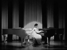 "Just incredible, the impeccably talented Hazel Scott playing TWO grand pianos in the 1943 Mae West film, ""The Heat is On."""