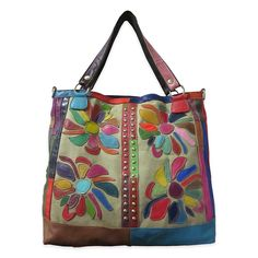 Accent your Boho chic look with this leather tote bag by Amerileather. Showcasing a vibrant floral design in brightly colored leather patches, this bag offers a fun accent to your casual look. The det Leather Purses, Leather Handbags, Leather Bag, Canvas Leather, Floral Tote Bags, Spring Fashion Casual, Boho Fashion, Leather Flowers, Handbags Online