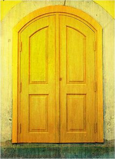 yellow doors in yellow wall