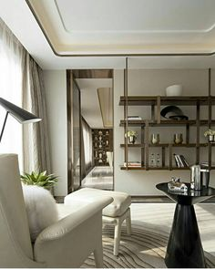 Shelves can add a completely different dimension to #moderninteriors. This #design via @steveleungdesigners is a classic #designinspirations with multiple layers of creative #styling. #armchair #shelves #livingroom #trend #highend #luxury #luxuryliving #homedecor #roominspiration #homeinspiration #design #interiordesigning #interiorstyling #furniture #luxuryfurniture