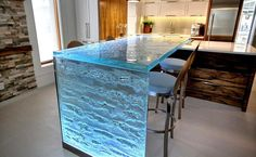 The photo gallery below offers 18 extremely elegant glass countertop ideas for your kitchen that will surely change your mind if you have decided to choose a countertop of another material.