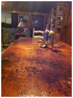 Hammered copper table top in natural fire patina by Copperhead Sinks