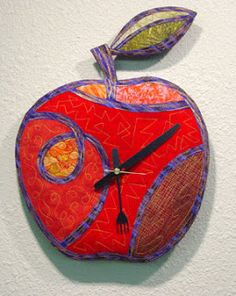 A quilted apple kitchen clock-- what an interesting idea.  -from Loreen Leedy's Studio: The Quilted Apple Clock That Gave Me a Hard Time