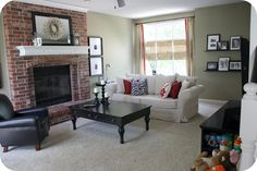 """Red brick fireplace with a slightly greenish stone colour on the walls - Farrow and Ball """"Old White"""" - add a flash of rich red in the cushions"""