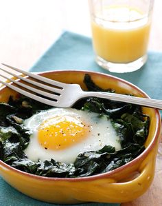 Bake eggs over wilted baby spinach for a light but decadent breakfast. #low-carb #gluten-free