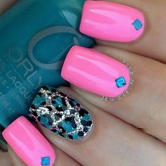 Bubblegum Pink Mani with a Blue Rhinestones and a Silver and Blue Leopard Print Accent Nail