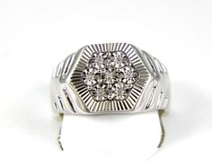 This a Fine Round Diamond Cluster Men's Fashion Ring Band. It has a CTW of. 03Ct and weighs 6.2 grams. The fancy diamonds have a clarity of I1 and G color. This beautiful custom piece has excellent round cut diamond stones that form into a square cluster at the base of this wide rugged men's ring. | eBay!