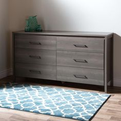 This dresser featuring contemporary lines and modern metal handles offers six spacious drawers for all your clothing storage needs. Its sleek refined look stands out from the rest making it perfect for creating a high end look at a low price. Features: Features 6 practical drawers Metal drawer slides Requires complete assembly by 2 adults (tools not included) Ships in a heavy box, make sure to have a friend with you