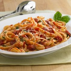 Fettuccine Pasta with Tomatoes and Garlic    I add baked chicken to this dish for some variety.  Very tasty.