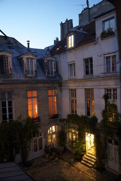 from my window tonight Paris: inner courtyard of a residential building. Apartments are built around a central courtyard. Very similar to our house in Paris, built in the inner courtyard of a residential building. Apartments are built around a Places To Travel, Places To See, Little Paris, Belle Villa, Paris Apartments, Parisian Apartment, Tour Eiffel, Architecture, Beautiful Places