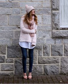 Wear a rose pink fuzzy crew-neck sweater with deep blue slim jeans for a standout ensemble. Pink leather heeled sandals will bring a classic aesthetic to the ensemble.  Shop this look for $119:  http://lookastic.com/women/looks/beanie-dress-shirt-skinny-jeans-heeled-sandals-scarf-crew-neck-sweater/1016  — Pink Beanie  — White Dress Shirt  — Navy Skinny Jeans  — Pink Leather Heeled Sandals  — Pink Scarf  — Pink Fluffy Crew-neck Sweater