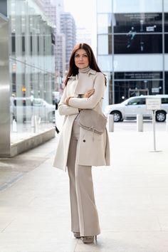 Gucci coat, sweater, and pants. Nina Ricci bag. Portolano gloves. Christian Louboutin fur boots.