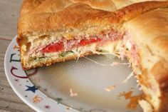 Italian Sandwich Torte filled with salami, spinach, cheese, and roasted red peppers. Eggs mixed with parmesan cheese bind everything together.