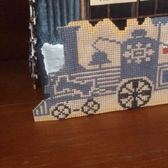 """Santa Rides"" cross stitch pattern by Prairie Schooler. I decided to display this cute pattern with paper mache train station I made. Frankly speaking, the result made me quite satisfied👯☺️ 🎄🎅☺️😘😣😚 ""#papermache #inspiration #crossstitch #crossstitching #crossstitchersofinstagram #вишивка #вишивкахрестиком #pointdecroix #embroidery # cushion #crossstitchlove #crossstitchpattern #crossstitch_inspiration #borduren #broiderie #ricomo #puntocruz #christmas #christmasdecorations…"
