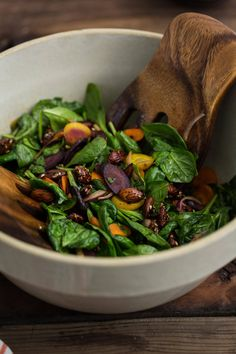 An easy salad to get you through the cooler months, this vegan carrot salad features sesame almonds, spinach, and a go-to miso-lemon dressing.