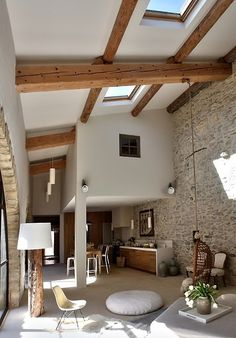 Old beam/stone meet contemporary clean lines in this airy living space