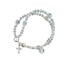Swarovski Crystal Wrist Rosary Catholic Jewelry This stunning bracelet unclasps to become a full Catholic rosary of gorgeous, petite genuine crystal beads and tiny cross and Marian charms. 4MM Swarovski Crystal Hail Mary's, 6MM Preciosa Crystal Our Father beads with Sterling Silver components. Measures 7.5 inches with magnet clasp.Place into your cart or wish list above.