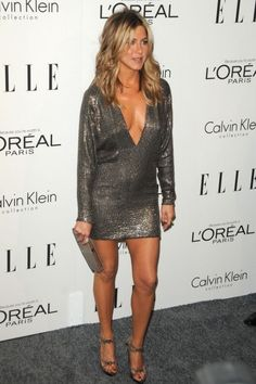 Jennifer Aniston in a plunging shimmering long sleeve mini dress and fabulous high heels