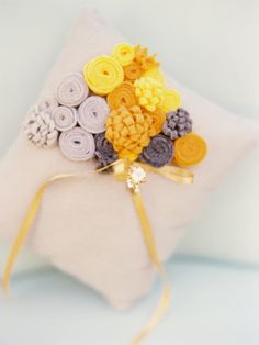 Love this ring pillow KGDesign on Etsy (although if you're feeling crafty, we have instructions on how to make flowers like these in our book Handmade Hellos!)