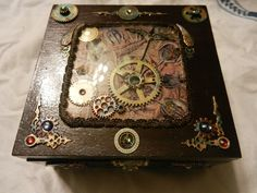 Top : Steampunk Gothic Treasure Jewelery Box, with Trilobites & Time Keeper Images, brass & copper patina paint / varnish, as well as natural rust & weathering, faux gems, Vintage clock crystal,  watch & clock parts & gears, altered cigar box.