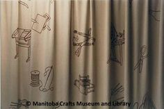 Crafts Guild of Manitoba  Approx 2 2/3x5 1/3 yds each drape. Hand embroidered in brown embroidered thread with spinning wheels, shuttles, embroidered frames, ball wool with knitting needles, reel thread with needle, scissors, small loom.  (Used as kitchen divider in Guild Hall from 1970-1985.  Also used in lounge. In new building hung as divider in basement staff room, 1986.) Staff Room, Spinning Wheels, Knitting Needles, Scissors, Loom, Basement, Divider, Frames, Lounge