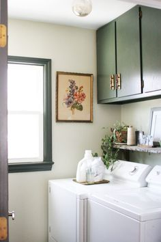 Beautiful Vintage Laundry Room with Dark Green Cabinets – Craftivity Designs Tour a beautiful Vintage Laundry Room with Dark Green Cabinets. Tons of storage using vintage Laundry Room decor that is functional, stylish, and practical! Room Makeover, Room Design, Interior, Green Cabinets, Laundry Room Design, Home Decor, Room Decor, Room Storage Diy, Vintage Laundry Room