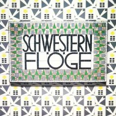 A mosaic sign designed by Koloman Moser in 1904 for the Schwestern Flöge, a fashion salon in Vienna owned and operated by the Flöge sisters Emilie, Pauline and Helene. at Neue Galerie New York.