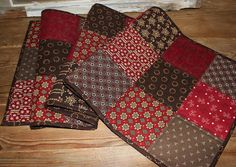 Red patches quilted table runner by ThePrimitivePear on Etsy
