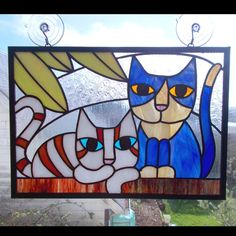 Brighten up a room with this cute cat themed stained glass panel. Two colorful kitties are depicted perched on a wall with some colorful foliage
