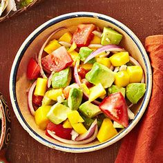 Mango, Tomato, and Avocado Salad This beautifully hued salad features fresh tomato, avocado, and mango, the peach of the tropics. Look for fairly large mangoes, which have a higher fruit-to-seed ratio than smaller ones, and buy only those that are yellow with a blush of red.