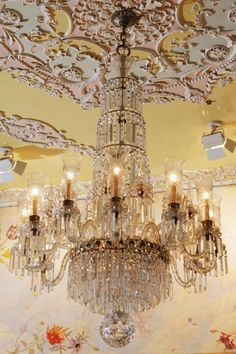 """Waterford Regency-Style Chandelier from the Crystal Room,  molded and cut-glass 12-light chandelier is of early 20th-century design and features a central stem enclosed by four tiers of graduated curtained rings supporting 12 s-scrolled arms with serrated bobêche flanking spike finials. It is hung throughout with beaded pendants and coffin prisms terminating in a large faceted spherule (ball) drop. Appraised by Sotheby's in 2007 for 80,000. $  Approx. H72"""" x 44"""""""