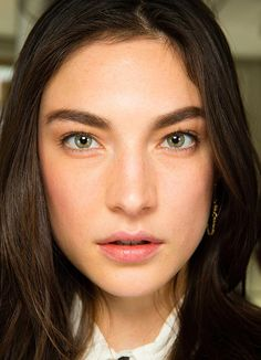 After the graphic glitter eye at S/S 2014, Jason Wu A/W 2014 opted for a softer, boyish feminine look with strong brows and lightly contoured skin.