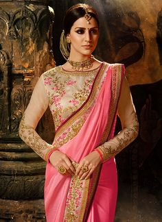 Shaded Pink and Beige Silk Saree features a bangalori silk blouse alongside a silk saree. Embroidery work is completed with zari, resham, stone and lace embellishments.