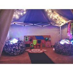 "Finished product of internship project: #SensoryRoom in under $200! Made with tailgating tent"" from Walmart, left over carpet from the house, Christmas lights, LED multicolored rope lights, bean bags, sensory board with materials from dollar store and scraps from Lowes, hanging tactile curtain, donated smell diffuser and sound machine. All of this creates a calming environment for autistic/impulsive kids to focus on their therapy activities."