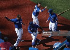 Melvin Upton Jr. #7 of the Toronto Blue Jays is congratulated by Edwin…