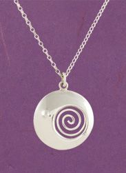 The spiral is a common motif in Celtic art, a symbol of the sun and its path through the sky as seasons change. An openwork spiral shines through this pendant, the rising sun beginning to outshine the crescent moon.