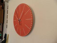 Orange colour clock. Modern clock. Hall Lobby Boy room Quiet