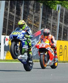 Valentino Rossi wheelies away from Marc marquez sachsenring 2014