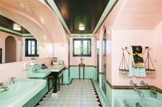 California Spanish Revival bathroom built Floor to ceiling tiles, minty green sinks/tub. Arch details above sinks and shower entry. Spanish Style Homes, Spanish Revival, Art Deco Bathroom, Bathroom Pink, Bathroom Faucets, Master Bathroom, Spanish Bathroom, Interior Window Shutters, Vintage Bathrooms