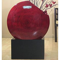 @Overstock - Sleek black rectangular stand is made from recycled pressed wood Decorative accessory measures 16 inches tall x 19 inches long x 9 inches wide Vase stand is made to hold the Giant Bamboo Vase (not included) http://www.overstock.com/Home-Garden/Black-Vase-Stand-for-Giant-Bamboo-Circle-Vase/3525336/product.html?CID=214117 $53.74