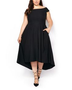 Every girl needs a little black dress! Try this stylish plus-size dress boasting a trendy off the shoulder design. It features short sleeves, a classic black hue and a flattering silhouette with pockets, flared bottom and high-low hem. Dress it up with heels!