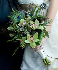 This bouquet is beautifully peacock with a touch of summer orchids! Beautiful...