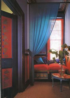 Vibrant blue, red, and black nook with a half curtain.  Gorgeous!