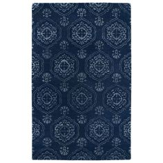 A new twist on a traditional masterpiece, this rug is hand-tufted in India of 100-percent wool accented with a striking touch of viscose. Featuring striking blue tones in a beautiful oriental pattern, this rug will be a welcoming addition to any room.