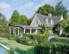 "frances schultz renovated her east hampton home ""bee cottage"" and  created an outdoor room with gorgeous landscape surrounding it.  note the gate in the hedge..."