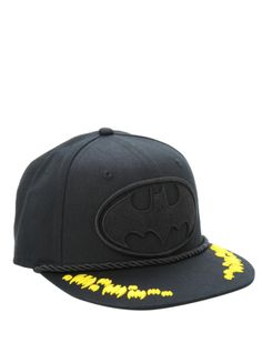 Black snapback hat with an embroidered black Batman logo and yellow bats.  Black Snapback Hats 3e492171dce7