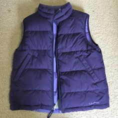 L. L. Bean Vest Purple best for the winter. Very nice quality with down feathers for warmth. The vest is reversible however, in the 2nd photo you see a stain of a footprint. And in the 3rd you see 2 rips that have been sewn up. If you wear this vest with the dark purple side however, it looks brand new. This is technically a Kids M 10-12, but fits a women's XS. L.L. Bean Jackets & Coats Vests