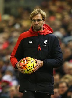 Jurgen Klopp manager of Liverpool holds the match ball during the Barclays Premier League match between Liverpool and Swansea City at Anfield on...