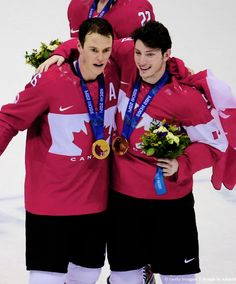 Jonathan Toews and Matt Duchene pose for a photo with their gold medals. #Sochi2014